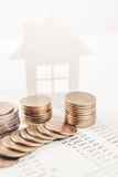 Business advertisement family home concept and growing pile coin stock photos