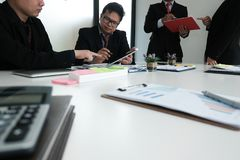 Business adviser analyzing company financial report. professional investor discussing idea. businessman working on startup. Business adviser analyzing company stock image
