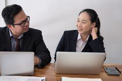 Business adviser analyzing company financial report. professiona. L investor discussing balance sheet data. businessman & businesswoman working on new startup Royalty Free Stock Photography