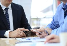 Business adviser analyzing financial figures Royalty Free Stock Images