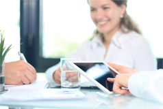 Business adviser analyzing financial figures Royalty Free Stock Image