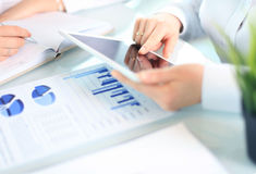 Business adviser analyzing financial figures Stock Images