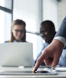 Business adviser analyzing financial figures Stock Photo