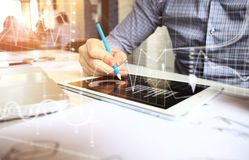 Business adviser analyzing financial figures denoting the progress in the work of company Royalty Free Stock Image