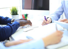 Business adviser analyzing financial figures denoting the progress in the work of the company. Stock Images