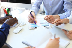Business adviser analyzing financial figures denoting the progress in the work of the company. Royalty Free Stock Photos