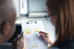 Business adviser analyzing financial figures Royalty Free Stock Photos