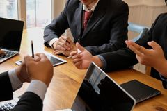 Business adviser discussing with businessman & professional investor. internal auditor audit performance revenue. team meeting. At office royalty free stock photo