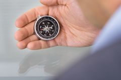 Business advisor holding compass Royalty Free Stock Photo