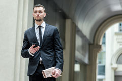 Business affairs! Confident businessman standing on the street a stock photo