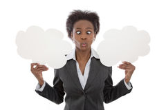 Business; African woman crossed eyed holding cloud signs isolate Stock Photography