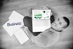 Business against young creative businessman working on laptop Stock Photo
