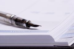 Business agenda. Close-up of opened empty agenda with pen royalty free stock image