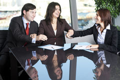 Business agreement. Businesswoman mediating and making business conciliation possible Royalty Free Stock Photo
