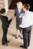 Business agreement. Business people shaking hands making an agreement Stock Image