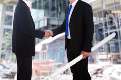 Business agreement at construction site. Anonymous businessmen shake hands at construction site Royalty Free Stock Photography