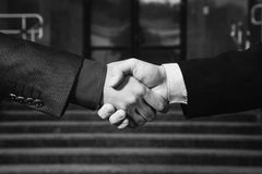Business agreement. Handshake on background Bank. Shake hands with each other royalty free stock photos
