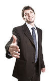 Business agreement - suit man offering handshake Stock Photos