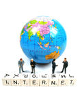 Business all over the world. Some businessmen in front of the globe with the word internet spelled out stock photo