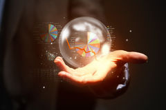Business ambitions. Close up of businesswoman holding bubble with graphs in hand Stock Images