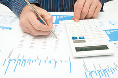 Business analysis. Calculator, sheet, graph, (business report) and analyst royalty free stock photo