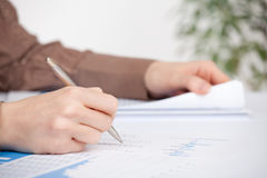 Business analysis. Sheet, graph, (business report) and analyst. Selective focused on pen royalty free stock photos