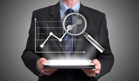 Business analysis concept appearing above a tablet Stock Photo
