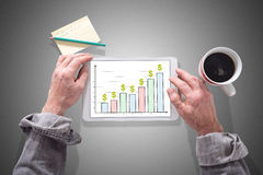 Business analysis concept on a tablet. Male hands using a tablet showing business analysis concept Stock Image