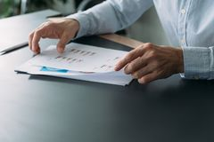 Business analysis man working graphs charts. Business analysis. Cropped shot of man working with graphs and charts. Blur background. Copy space stock photo