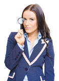 Business Analysis Review And Strategy Examination. Isolated Studio Portrait Of A Young And Pretty Business Girl Or Lady Holding A Magnifying Glass Up To Eye In A Stock Image