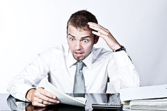 Business Analysis Shock. Young Corporate  Man Having A Shock When Reviewing Some Documents Stock Image