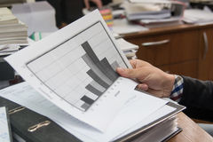 Business analyst examining diagram stock images
