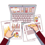 Business analyst hands holding statistical data. And using laptop computer making online sales analytics report. Modern flat style thin line top view vector Stock Photo