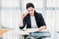 Business analyst report papers graph information. Business analyst studying report papers with graphic results of company activity. information processing and royalty free stock photo