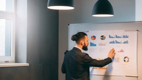 Business analyst studying company growth rates stock photography