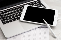 Business analytic with digital tablet. Isolated and laptop computer stock photography