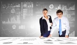 Business analytics. Businessman and businesswoman analyzing data information of market Stock Photo