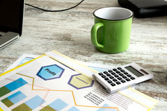 Business Analytics with Coffee. Business analytics with a Data sheet and a cup of coffee Stock Photography