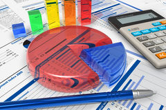 Business analytics concept. Color crystal charts, calculator and pen on financial reports Stock Images