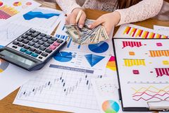 Business analytics with graphs, diagrams and chart. On wooden table stock image