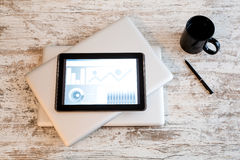 Business Analytics with a Tablet PC and a closed Laptops Stock Photography