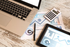 Business Analytics with a Tablet PC and a Laptop royalty free stock photography