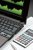 Business Analyze. Modern business and stock market analyze with laptop, calculator, pen and printed data sheet stock images