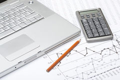 Business analyze. With laptop, calculator and printed data sheet stock image