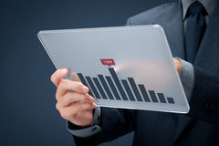 Business analyze. Businessman with futuristic glass tablet analyze business data stock photo