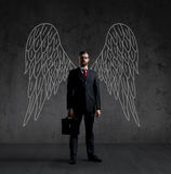 Business angel on a dark background. Business angel over dark background. Investment, business, sponsor concept Stock Photo