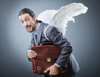 Business angel with money. On grey Royalty Free Stock Images