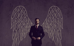 Business angel over dark background. Investment, business, sponsor concept. stock image