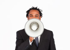 Business announcement through megaphone. Afro-american businessman making announcemnt through megaphone Royalty Free Stock Image