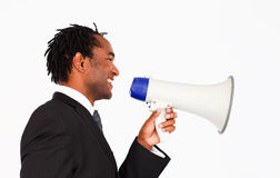 Business announcement through megaphone. Afro-american businessman making announcemnt through megaphone Royalty Free Stock Photography